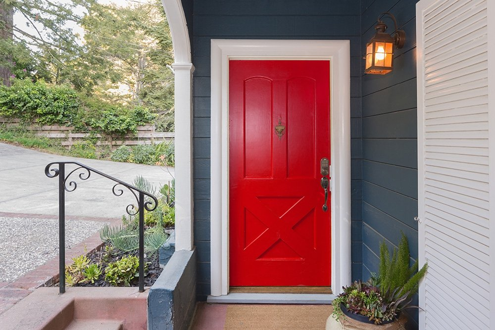 Red entry Door to a house